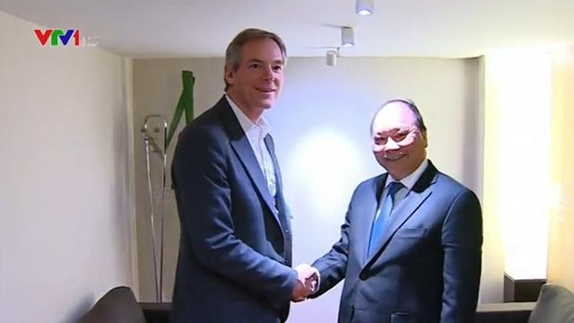 Thủ tướng tiếp lãnh đạo các tập đoàn hàng đầu thế giới - Ảnh 1.