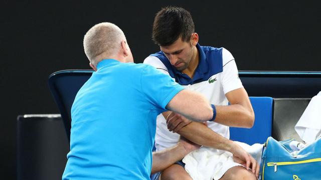 Djokovic đối mặt nguy cơ tiếp tục nghỉ dài hạn vì chấn thương - Ảnh 1.