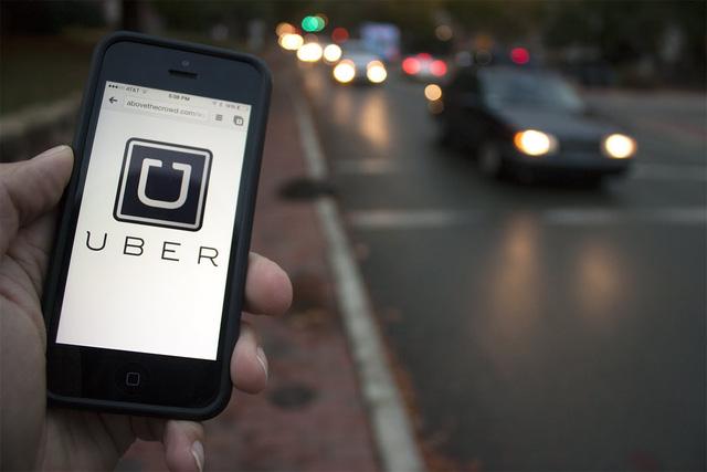 Nhân viên Grab làm việc ngày đêm để tiếp quản Uber - Ảnh 1.