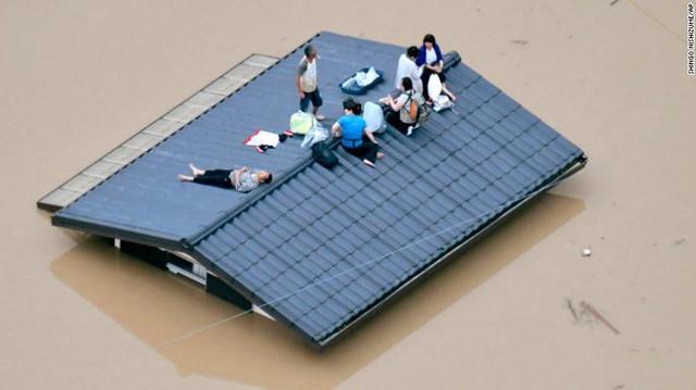 Gia tăng thương vong do mưa lũ ở Nhật Bản - Ảnh 3.