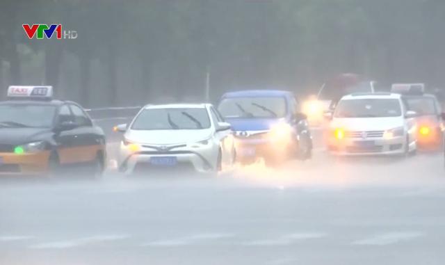 Mưa lũ gây ngập lụt nghiêm trọng ở Trung Quốc - Ảnh 1.