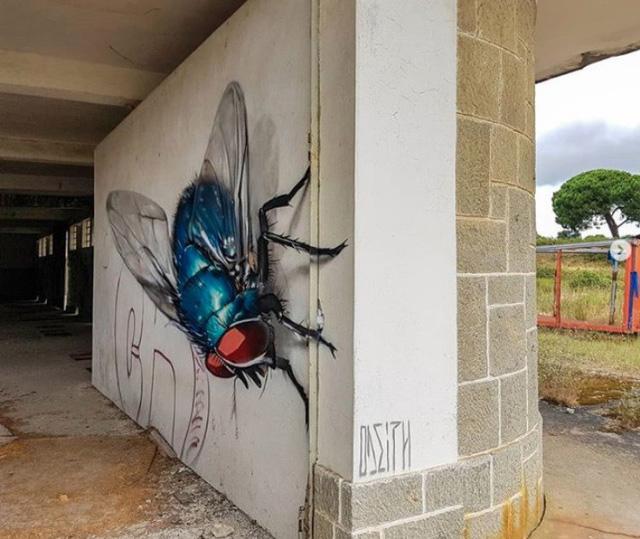 Những tác phẩm graffiti sống động như thật - Ảnh 3.