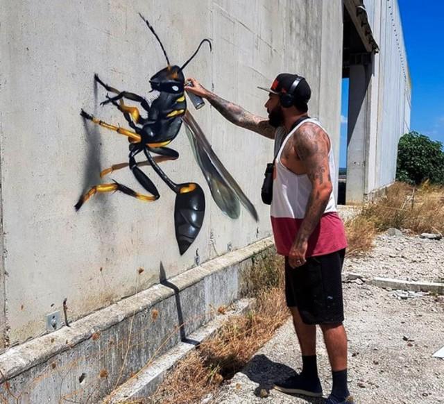 Những tác phẩm graffiti sống động như thật - Ảnh 7.