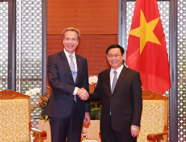 Phó Thủ tướng Vương Đình Huệ tiếp các tập đoàn lớn dự WEF ASEAN 2018 - Ảnh 1.
