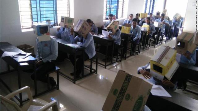 Hình ảnh học sinh phải đội thùng carton để chống gian lận thi cử khiến nhiều người phẫn nộ - Ảnh 1.