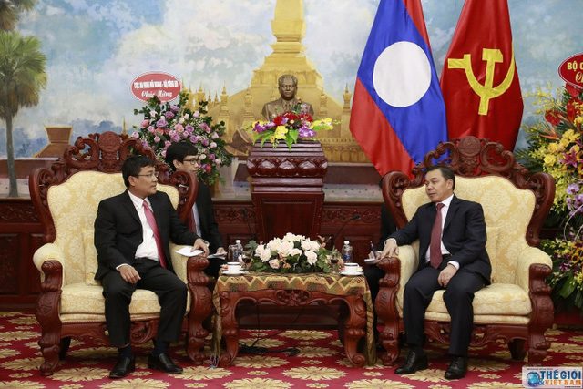 Thứ trưởng Ngoại giao Nguyễn Minh Vũ chúc mừng Quốc khánh CHDCND Lào - Ảnh 2.