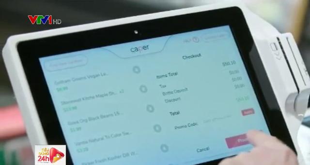 Xe đẩy thông minh cho phép quét mã hàng hóa để thanh toán - Ảnh 1.