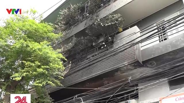 Hiện trường vụ cháy nhà khiến 3 người tử vong ở TP.HCM - Ảnh 1.