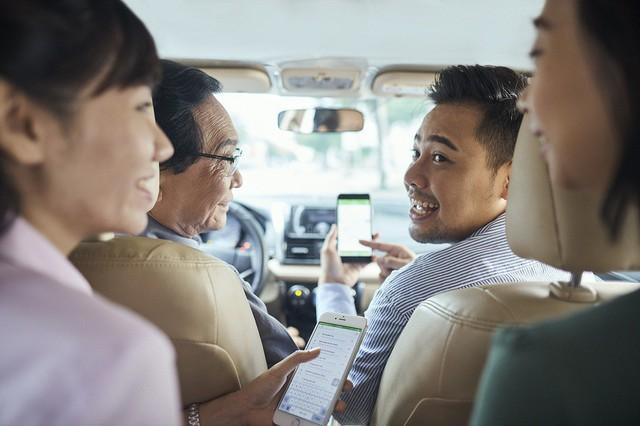 FPT hợp tác với Grab phát triển các giải pháp giao thông thông minh - Ảnh 1.