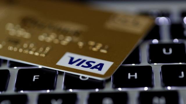 Visa thử nghiệm dịch vụ rút tiền mặt tại các quầy thanh toán ở Nga - Ảnh 1.