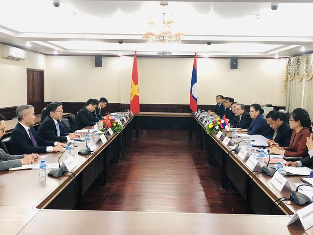 Thứ trưởng Ngoại giao Nguyễn Quốc Cường thăm làm việc tại Lào - Ảnh 2.