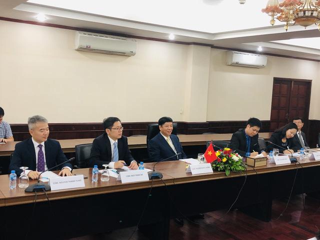 Thứ trưởng Ngoại giao Nguyễn Quốc Cường thăm làm việc tại Lào - Ảnh 1.