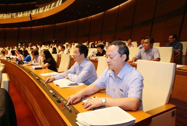 Quốc hội biểu quyết thông qua Luật sửa đổi, bổ sung một số điều của Luật Kinh doanh bảo hiểm và Luật Sở hữu trí tuệ - Ảnh 1.