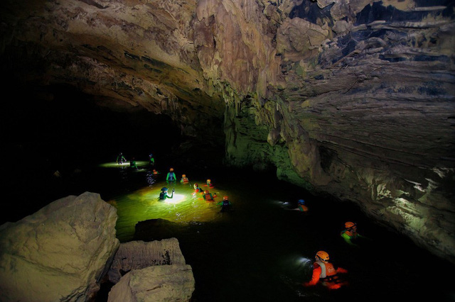 The Google Adventure Vietnam production team members wade inside Tu Lan Cave in Quang Binh Province, north-central Vietnam. Photo: Google Adventure Vietnam
