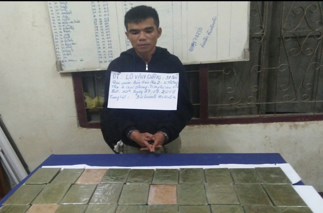 Thanh Hóa: Bắt 2 đối tượng vận chuyển lượng lớn heroin từ Lào vào Việt Nam - Ảnh 1.