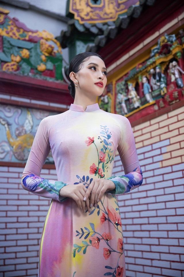 Hoa hậu Tiểu Vy khoe sắc mặn mà trong tà áo dài đón Tết - Ảnh 8.