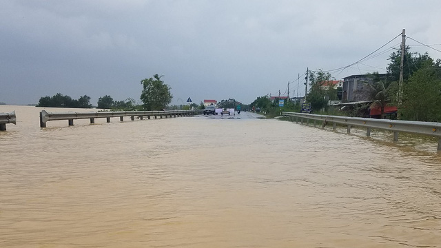 A main road is cut off by flooding in Quang Binh Province.