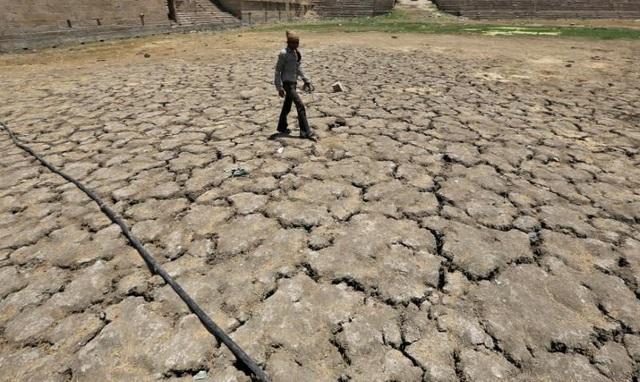 IMF: Biến đổi khí hậu đe dọa tăng trưởng kinh tế toàn cầu - Ảnh 1.