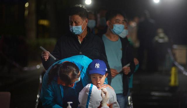 Trung Quốc phát hiện 137 trường hợp mắc COVID-19 không triệu chứng - Ảnh 1.