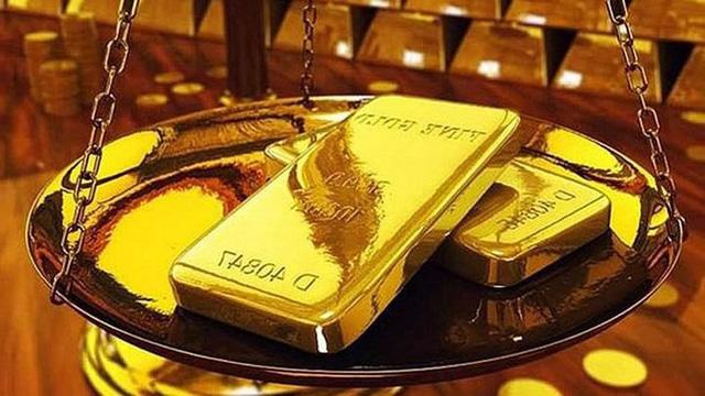 Giá vàng châu Á giảm xuống mức thấp nhất trong hơn một tuần - Ảnh 1.