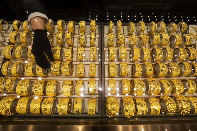 Giá vàng đi lên phiên cuối tuần tại thị trường châu Á - ảnh 1