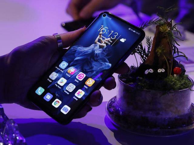 Huawei chính thức xác nhận bán con đẻ Honor - Ảnh 2.