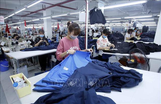 Nikkei: Việt Nam là nền kinh tế duy nhất chiến thắng đại dịch ở ASEAN - Ảnh 1.