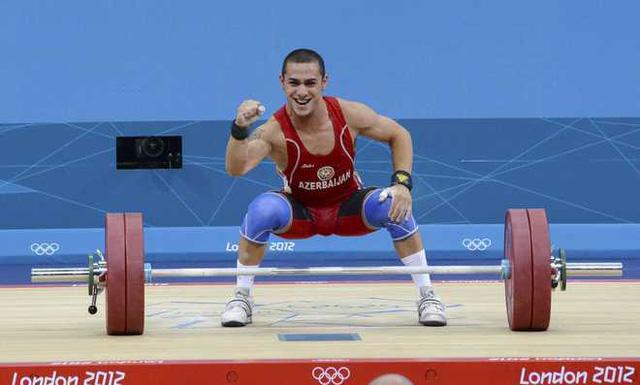 Trần Lê Quốc Toàn bất ngờ nhận HCĐ cử tạ Olympic London 2012 - Ảnh 1.