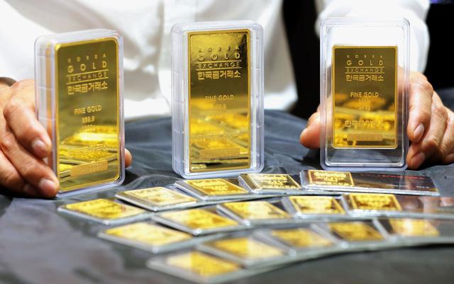 Giá vàng châu Á đi lên phiên 26/11 do đồng USD suy yếu - ảnh 1