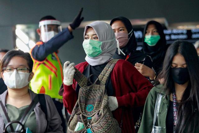Dịch bệnh tại một số nước Đông Nam Á vẫn diễn biến phức tạp - Ảnh 1.