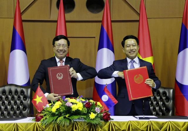 Việt Nam - Lào tiếp tục phối hợp chặt chẽ tại các diễn đàn khu vực và quốc tế - Ảnh 2.