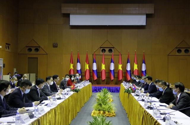 Việt Nam - Lào tiếp tục phối hợp chặt chẽ tại các diễn đàn khu vực và quốc tế - Ảnh 1.