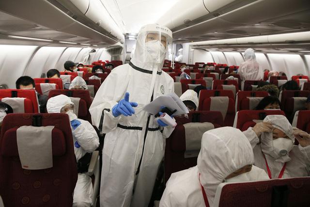 Trung Quốc khuyến cáo tiếp viên hàng không bổ sung biện pháp bảo hộ để phòng ngừa COVID-19 - Ảnh 1.