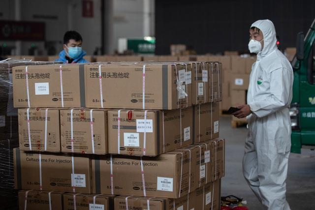 Các doanh nghiệp tại Trung Quốc cố gắng vực dậy giữa cơn bão Corona - Ảnh 3.