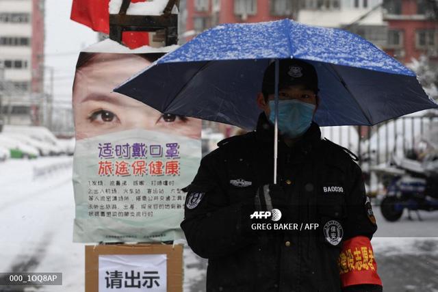 Các doanh nghiệp tại Trung Quốc cố gắng vực dậy giữa cơn bão Corona - Ảnh 4.
