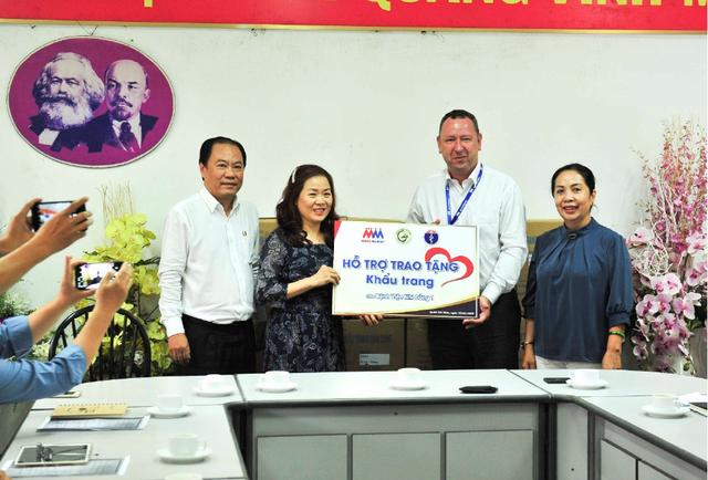 MM Mega Market Việt Nam tặng 20.000 khẩu trang cho bệnh viện Nhi đồng 1 - Ảnh 1.