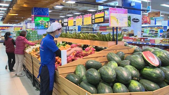 Các doanh nghiệp Hà Nội hỗ trợ nông dân tiêu thụ nông sản - Ảnh 2.