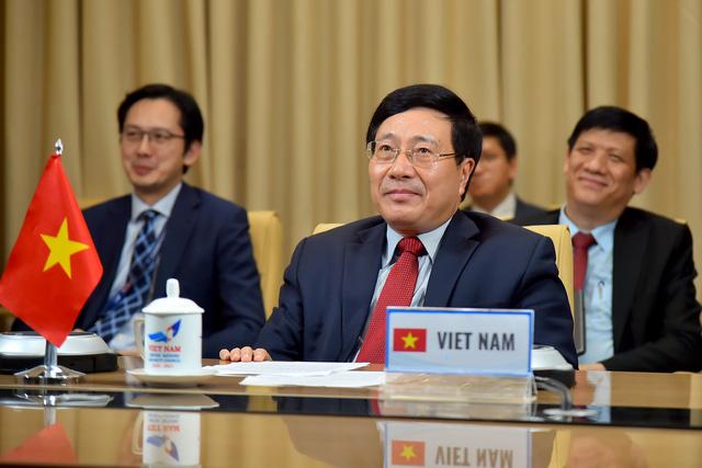 Phó Thủ tướng Phạm Bình Minh nêu 4 đề xuất để cộng đồng quốc tế ứng phó hiệu quả với COVID-19 - Ảnh 2.