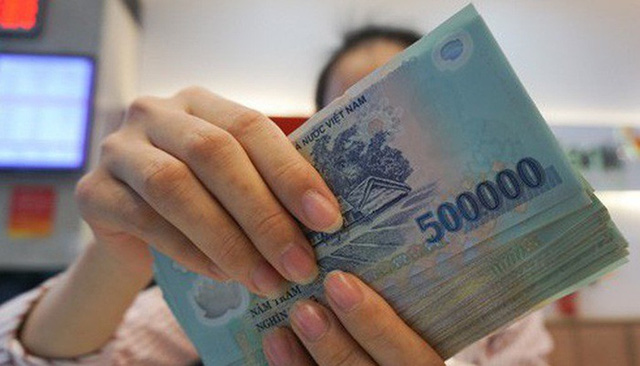 Từ hôm nay (13/5), lãi suất tiền gửi không kỳ hạn tối đa chỉ còn 0,2% - Ảnh 1.