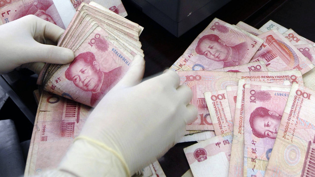Trung Quốc triệt phá đường dây làm tiền giả trị giá 60 triệu USD - Ảnh 1.
