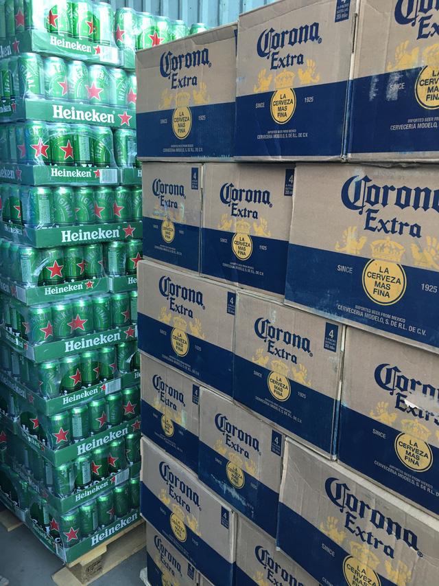 Phát hiện lô hàng sữa và bia ngoại nhập lậu số lượng khủng - Ảnh 1.
