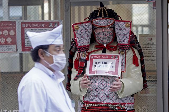 Nhật Bản rơi vào suy thoái - Ảnh 2.