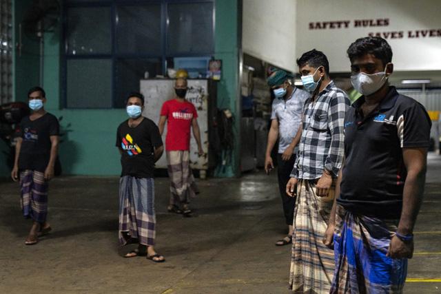 Lao động nhập cư - Ổ dịch COVID-19 tại Singapore - Ảnh 3.