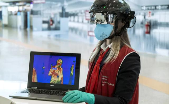 Mũ bảo hiểm robot kiểm tra hành khách tại sân bay - Ảnh 2.