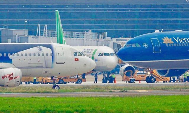 Bộ Giao thông Vận tải yêu cầu các hãng hàng không chưa đón khách quốc tế - Ảnh 1.