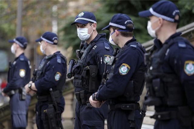 Số ca nhiễm COVID-19 tăng trở lại, Australia khôi phục các lệnh hạn chế - Ảnh 2.