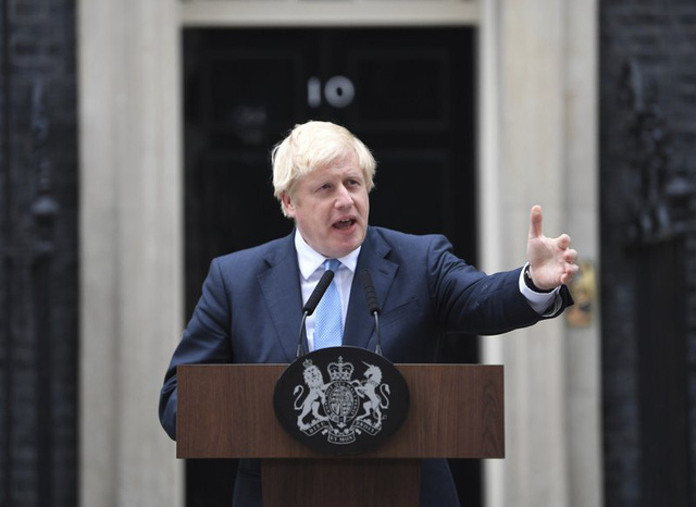 Thủ tướng Anh: Sẽ sửa đổi luật để ngăn chặn khủng bố - Ảnh 1.