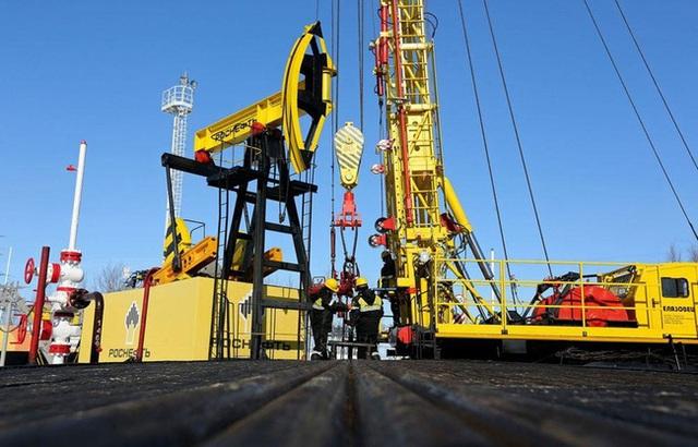 Giá vàng, giá dầu diễn biến ngược chiều trên thị trường thế giới - Ảnh 1.