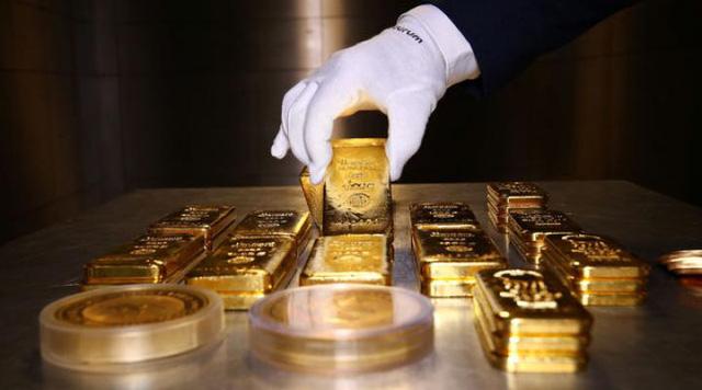 Giá vàng tăng nhẹ phiên đầu tuần, duy trì mức trên 50,5 triệu đồng/lượng - Ảnh 1.