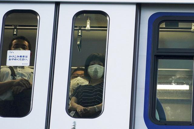 Gia tăng chóng mặt số bệnh nhân COVID-19, Tokyo cảnh báo mức cao nhất - Ảnh 1.